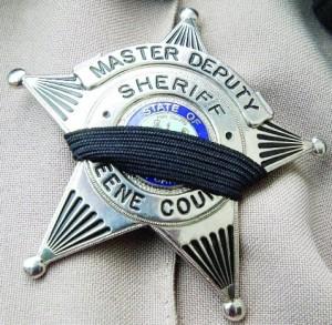 Greene Co deputys badge wiith mourning band